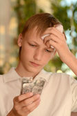 Sick boy with pills — Stockfoto