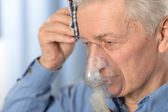 Close-up portrait of an elder man making inhalation — Foto Stock