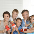 Happy family with gifts — ストック写真