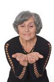 Senior woman giving something — Foto Stock