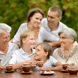 Family drinking tea outdoors — Stock Photo #42391825