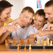 Stock Photo: Family at chess