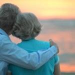 Elderly couple at sunset — Stock Photo