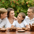 Happy family drinking tea — Stock Photo