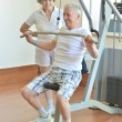 Elderly couple in a gym — Stock Photo #42392037