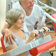 Elderly couple in a gym — Stock Photo #42392187