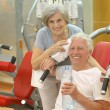 Elderly couple in a gym — Stock Photo #42392259