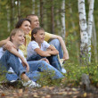 Happy family in a birch forest — Stock Photo