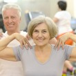 Elderly couple in a gym — Stock Photo