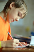 Boy is doing homework — Stock Photo