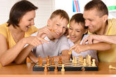 Family at the chess — Stockfoto