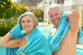 Amusing elderly couple in pool — Photo