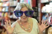 Senior woman in huge sunglasses — Stock Photo