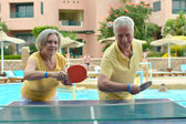 Elderly couple playing ping pong — Stock Photo
