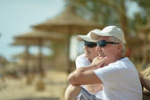 Amusing elderly couple on a beach — Photo