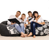 Family of four with laptop — Stock Photo