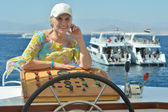 Senior woman having boat ride — Foto de Stock
