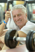 Elderly man in a gym — Stock Photo