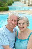 Nice old couple at pool — Stock Photo