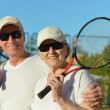 Senior couple playing tennis — Stock Photo #42880089