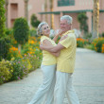 Senior couple at hotel resort — Stock Photo