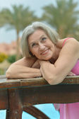 Senior woman at the resort — Stockfoto