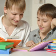 Two brothers doing homework — Stock Photo