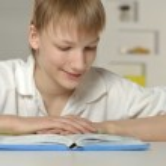 Teenage boy doing homework — Stock Photo #43805943