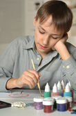 Boy painting at home — Stock Photo