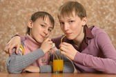 Two boys drinking juice — Stok fotoğraf