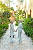 Senior couple at hotel resort — Stock Photo