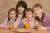 Family at table — Stock Photo