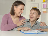 Mother with her son doing homework — Stock Photo