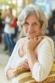 Senior woman in shopping mall — Stock Photo