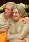Charming old couple at the resort — Stock Photo