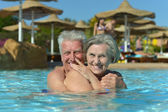 Senior couple at pool — Foto de Stock