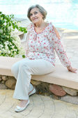 Senior woman at the resort — Stock Photo