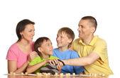Happy family playing lotto — Stock Photo