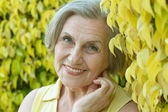Senior woman on nature — Stock Photo