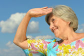 Senior woman on the background of sky — Stock Photo