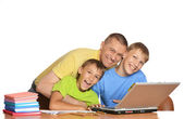 Boys doing homework with father — Stock Photo