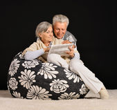 Aged couple at home — Stock Photo