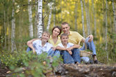 Family of four in forest — Stock Photo