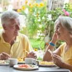 Elder couple eating breakfast — Stock Photo #45153833