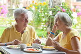 Elder couple eating breakfast — Stock Photo