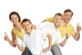 Family showing thumbs up — Stock Photo