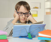 Young boy doing homework — Stock Photo