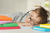 Young boy doing homework — Foto Stock