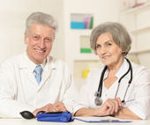 Doctor couple working at table — Stock Photo