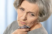Sick elderly woman — Stock Photo